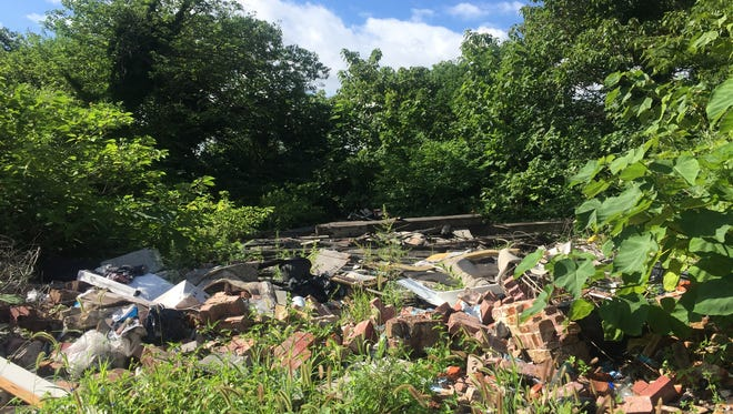 A pile of trash rests in a vacant lot in Camden. The city is hoping to secure a $1 million grant to combat illegal dumping and fill vacant lots with art.