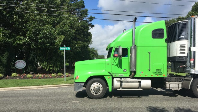 Vineland is restricting street parking inside its Industrial Park-South off Garden Road to facilitate large trucks, like this one passing the intersection of DeMarco Drive and Industrial Way on Friday,