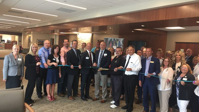 Local officials and Aurora leaders cut the ribbon the new Aurora Health Center at 3509 Dewey St. in Manitowoc Aug. 2.