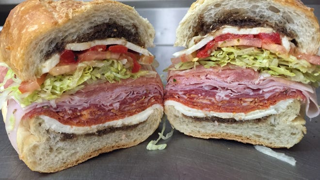 Named after owner Domenick Discenza, owner of Sapore Ravioli in Middlesex, the popular 'Dom' sandwich features fresh homemade mozzarella, red peppers freshly roasted onsite, imported prosciutto, soppressata, capicola, ham, pepperoni, salami, and oil and vinegar on an Italian baguette