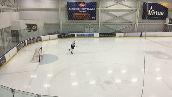 Vinny Lecavalier skated on his own before the Flyers practiced Friday.