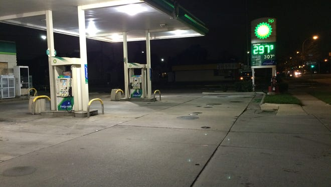 Three people were wounded when a marked man fired  a single shotgun blast  at a vehicle at this BP station on West Jefferson in Ecorse early this morning.
