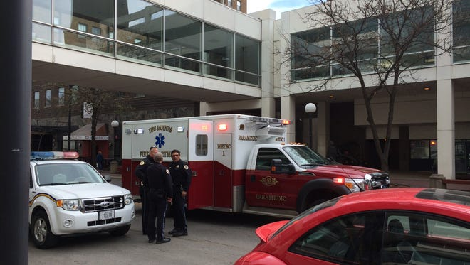 Des Moines police and paramedics responded to a false report of a shooting at Fifth Avenue and Walnut Street downtown late Friday morning.