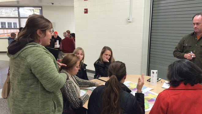 A group of West Des Moines parents review school boundary proposals at a forum held at Valley Southwoods Freshman High School Tuesday, Nov. 11, 2014.