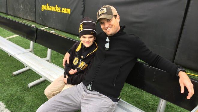 Masters champ Zach Johnson and son, Will, at Kinnick Stadium Saturday