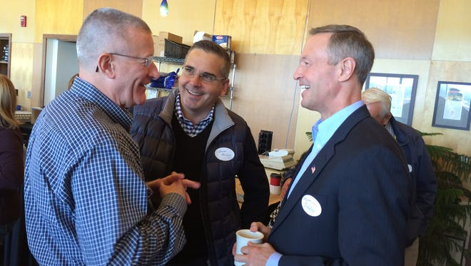 Maryland Gov. Martin O'Malley, right, talks with attorney George Appleby left, and state Sen. Matt McCoy in Des Moines.