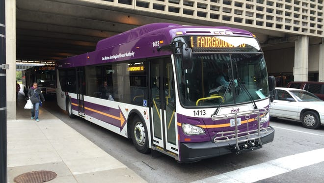 A new 40-foot DART bus drops off riders on 7th Avenue downtown Wednesday.