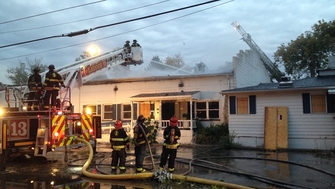 IFD crews pour water on a fire in a vacant building at 2800 W. Vermont Street.