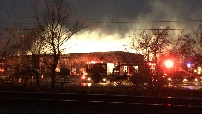 A Belleville bus depot continues to burn at Davis and South roads south of Belleville Lake on Thursday, November 13, 2014.