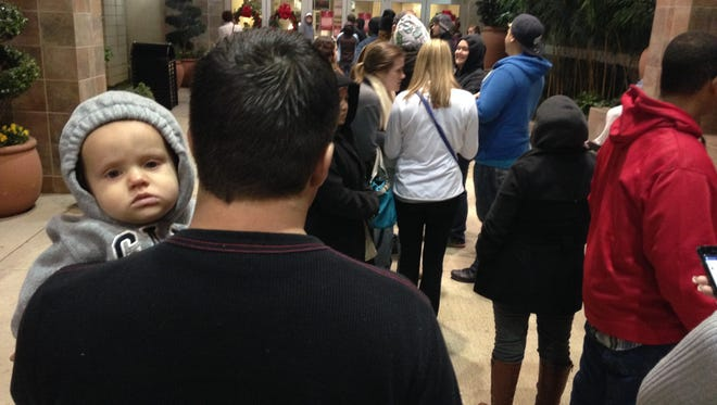 People wait in line Thursday for a gift card giveaway at Eastdale Mall in Montgomery.