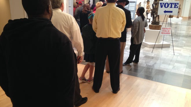 The first voters line up Tuesday morning at the Montgomery Museum of Fine Arts.