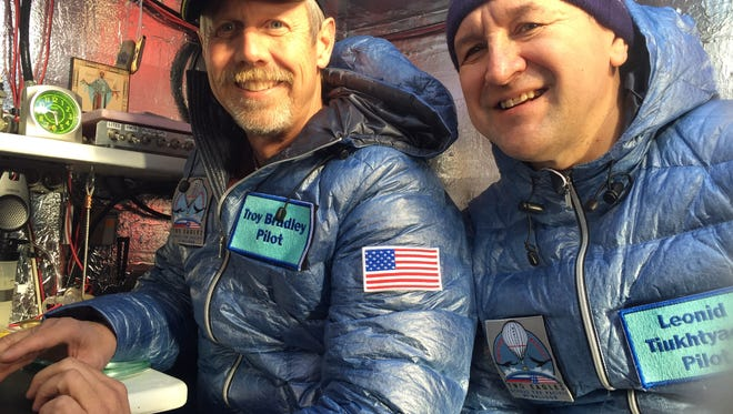 This Jan. 8, 2015 photo provided by Tami Bradley-Two Eagles Balloon Team, shows pilots from left, Troy Bradley of Albuquerque, N.M., and Leonid Tiukhtyaev of Russia, before they lift off in a gas balloon in Saga, Japan.
