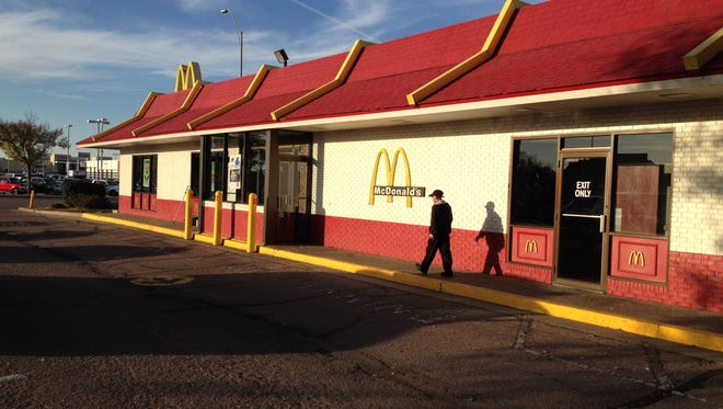 A man was arrested after allegedly attempting to rob someone with a knife in the parking lot of McDonald's, 4000 W. 41st St., on Thursday, Oct. 16, 2014.