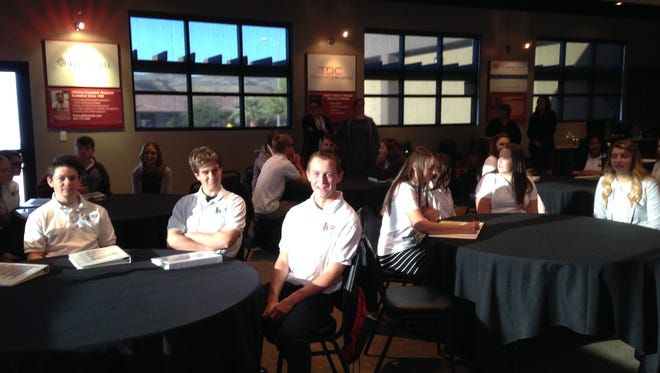 Leadership Academy students gather at Corporate Alliance on Thursday, Nov. 20, 2014 to learn about business and technology.
