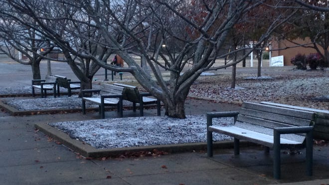 Snow-covered benches at the West Tennessee Farmers Market in Jackson.