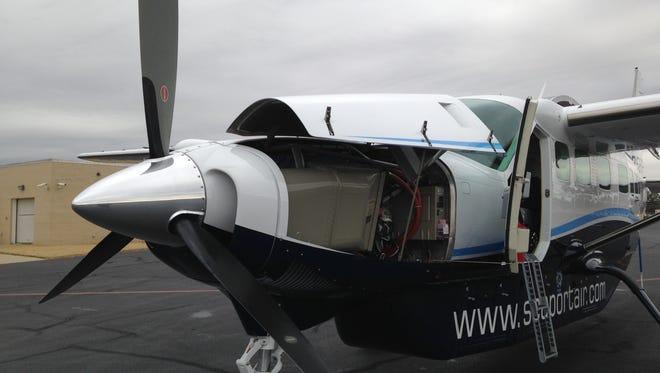 A Cessna 208B sits on the tarmac at McKellar-Sipes Regional Airport