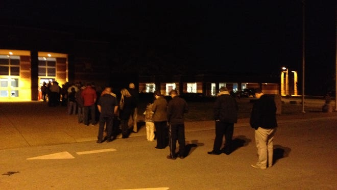 Voters waited in line to cast their ballots at Siegel Elementary School on Tuesday.