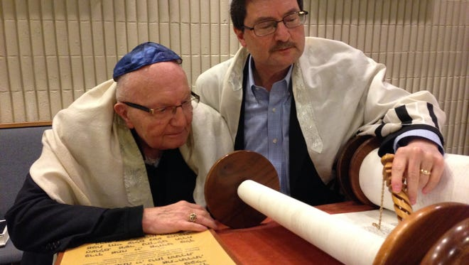Norman Alpert, left, and his son, Dr. Mitchel Alpert, review the Hebrew readings that will be a part of the elder Alpert's belated bar mitzvah ceremony during a weekday rehearsal at Temple Beth Or in Brick.