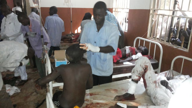 Wounded patients are treated at the General Hospital in Potiskum, Nigeria,  following a suicide bomb attack at Government Science Technical College Potiskum on Nov. 10..