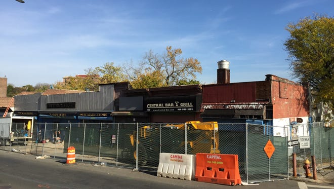 A row of storefronts at the intersection of New Main Street and Nepperhan Avenue in Yonkers on Tuesday. The buildings will be razed to create the third phase of the Saw Mill River park.