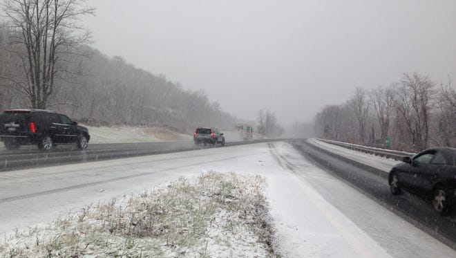 Vehicles moving slowly on Interstate 684 near Exit 4 as snow begins to cover the roadway Wednesday, Nov. 26.
