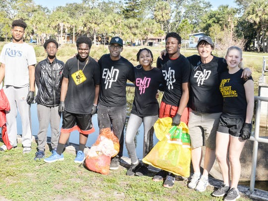 Volunteers from End It!: Jamari Stewart, left, Jevaughn Estime,  Azariah Murray, Strather and Sinclaire Dupree, Emmanuel Murray, Dani Dreizehnter and  Sophia Olsinski.