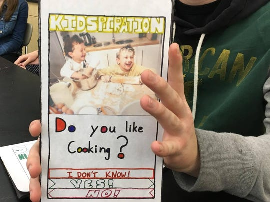 "Ty Brewen of West Salem High School shows the cardboard displays of ""Kidspiration,"" an interactive career app, on Jan. 19, 2016."