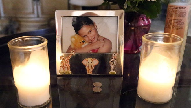 A photo of Samantha Aguilar is on a table in the family's living room.