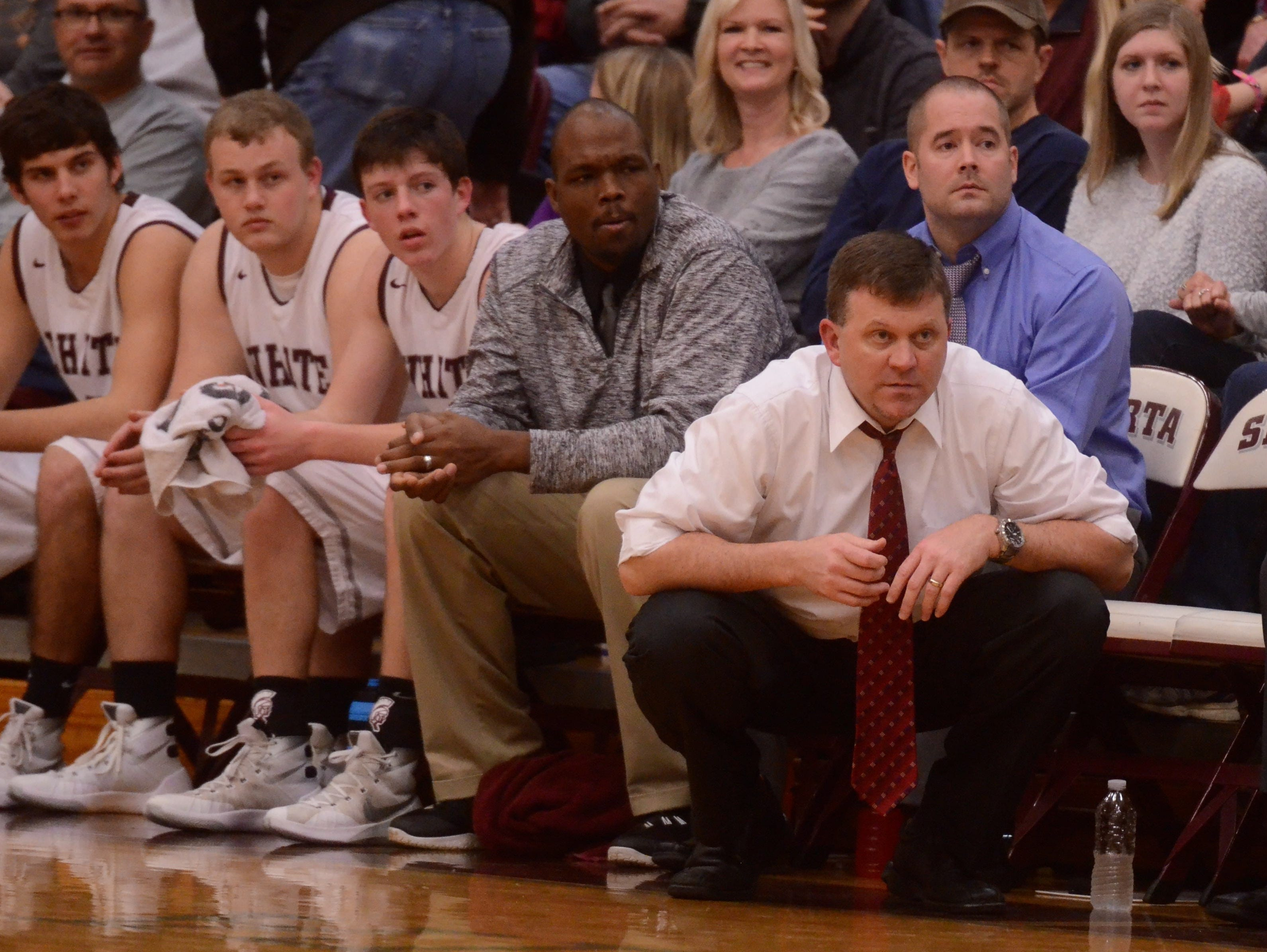White County coach Eric Mitchell (right) looks on during Monday's regular-season finale.