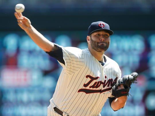 Minnesota Twins pitcher Lance Lynn throws against the