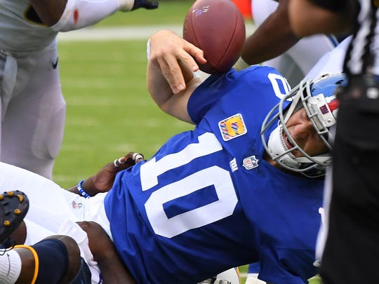 New York Giants quarterback Eli Manning fumbles late in the 4th quarter leading to a Chargers TD and win at MetLife Stadium.