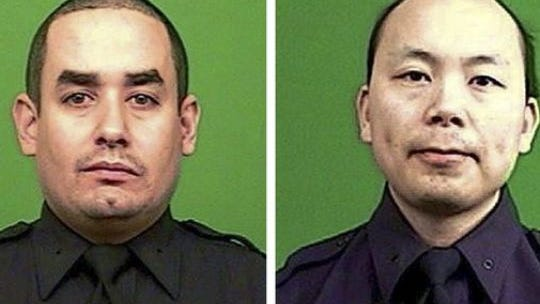 A combo handout picture released by the New York City Police Department shows officers Rafael Ramos, left, and Wenjian Liu.