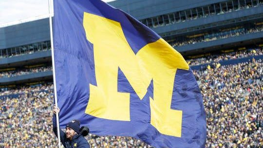 A Michigan flag flies to celebrate a touchdown against Michigan State during the second half at Michigan Stadium in Ann Arbor, Saturday, Nov. 16, 2019.