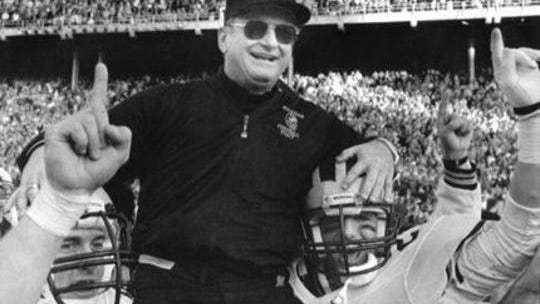 Michigan coach Bo Schembechler is carried from the field on Nov. 22, 1986 after a 26-24 vicotry over Ohio State for the Big Ten title and a trip to the Rose Bowl on New Year's Day.