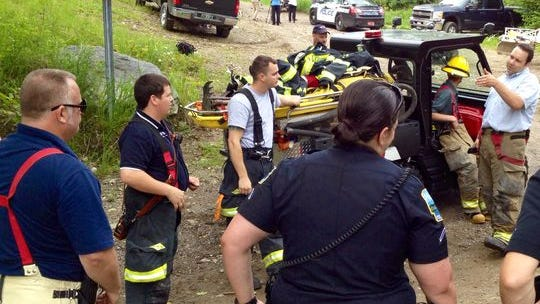 Police and fire officials respond after two people told police they lit their camp afire on Georgia Mountain along Westford Road to ward off a bear.