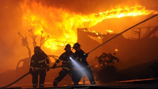 Firefighters battle a fire from a high-pressure gas line explosion in San Bruno, Calif., in 2010.