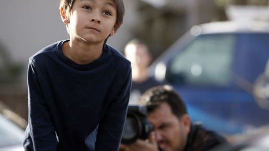 Falcon Heene, 6, sits in the box of his family's pickup truck outside their family's home in Fort Collins, Colo., after he was found hiding in the garage on Oct. 15, 2009. He had been reported to be aboard a flying-saucer-shaped balloon fashioned by his father and then carried by high winds on to the plains of eastern Colorado.