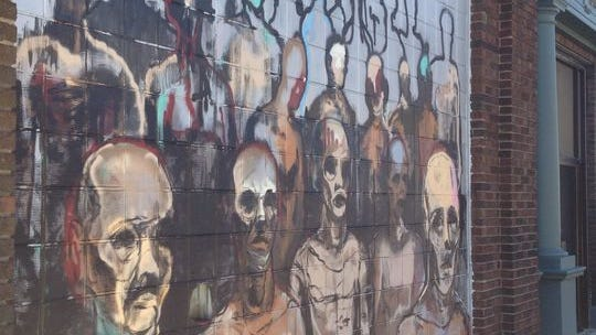 """Sagan Newham's """"Walking Men"""" graced a wall of Haywood Printing at Fifth and Ferry streets."""
