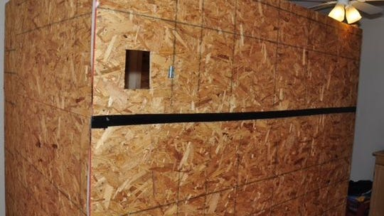 Plywood structure built inside the boy's bedroom.