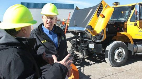 Gov. Jay Nixon tours a Missouri Department of Transportation maintenance facility with MoDOT Director David Nichols, left.