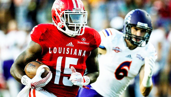Running back Elijah McGuire left UL has its all-time leader in scoring and all-purpose yards.