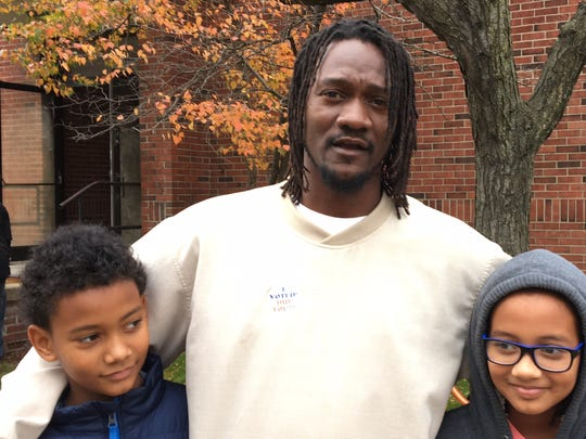 Masud McClure, 39, and his children Masud, 10 (left), and Maya, 11, exit the polling place at Tuesday, Nov. 8, 2016 at Woodward and Holbrook.