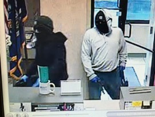 Two men robbing the Trustco Bank at 75 N. State Road