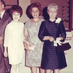 Alcestis Oberg's grandmother Alexandra Papagiane, right, with guests celebrating Oberg's wedding in August 1969.