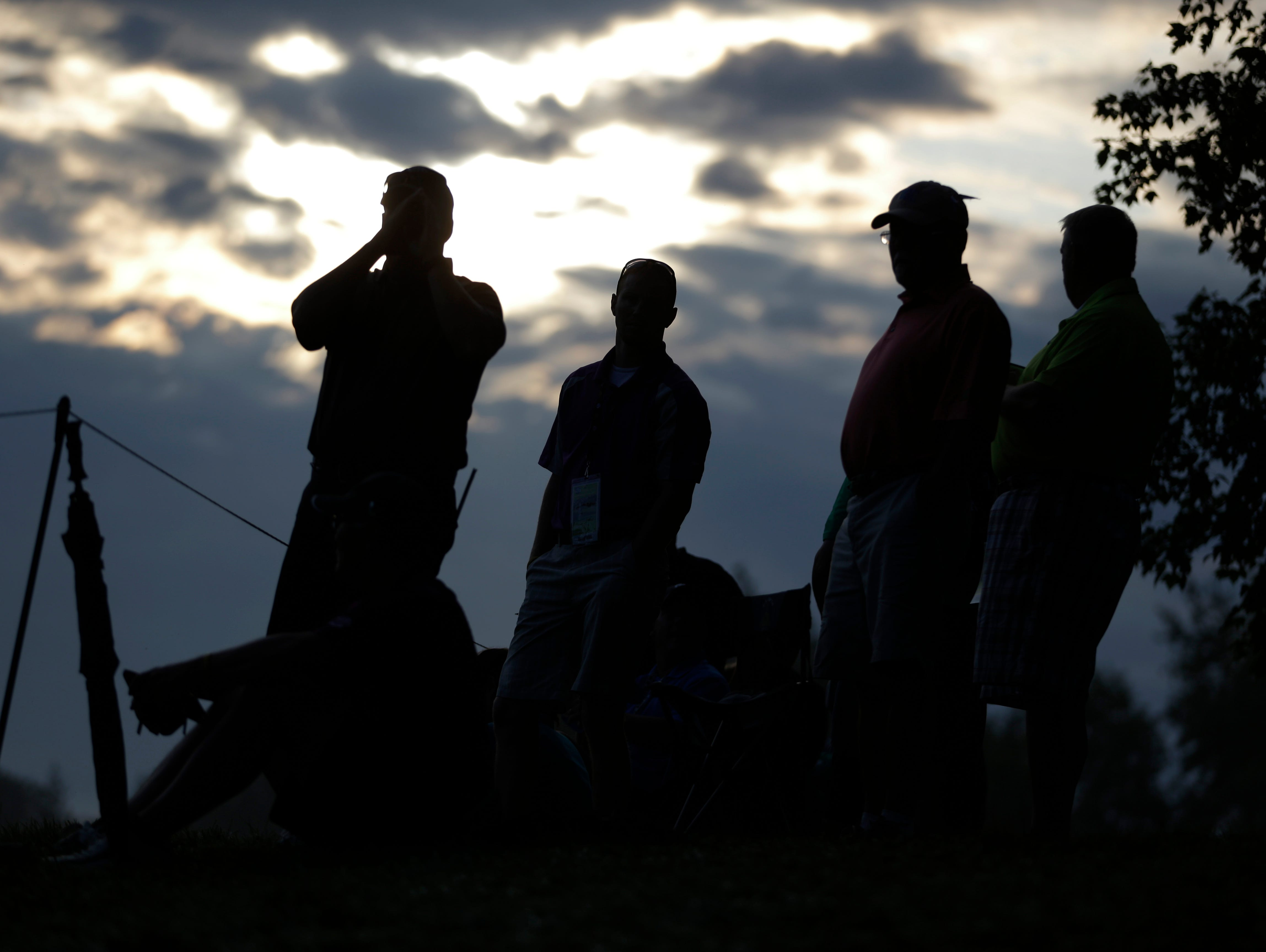 Members of the gallery wait for the start of the first round of the PGA Championship.