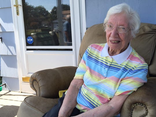 Rose St. George, 93, sits in her leather chair that the Town of Irondequoit says is a code violation.