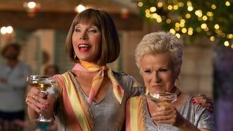 """Tanya (Christine Baranski, left) and Rosie (Julie Walters) toast in """"Mamma Mia! Here We Go Again."""""""