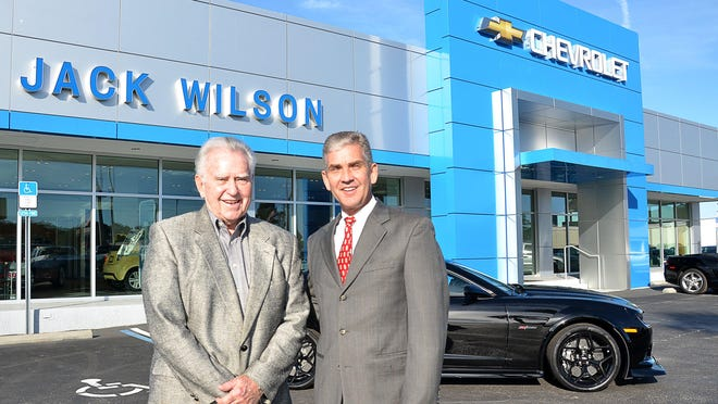 Brian Wilson, president and owner of Jack Wilson Chevrolet Buick GMC, stands with his father and company founder Jack Wilson in front of the dealership in 2015.