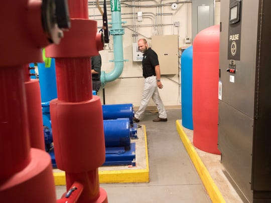 Andy Heitman, of Building Energy Sciences, LLC makes a visual inspection the power and mechanical plant at A.K. Suter Elementary School Thursday, Oct. 19, 2017.