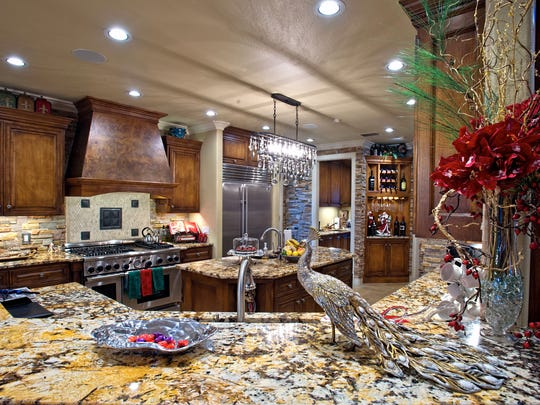 Beautiful granite counters, stacked stone, warm wood cabinetry and plenty of space makes the kitchen the perfect spot to entertain